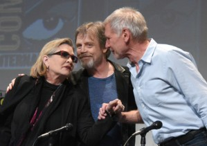 "FILE - In this July 10, 2015 file photo, Carrie Fisher, from left, Mark Hamill, and Harrison Ford attend Lucasfilm's ""Star Wars: The Force Awakens"" panel on day 2 of Comic-Con International in San Diego, Calif. Ford stars as Hans Solo in the new film, ""Star Wars: The Force Awakens,"" releasing in U.S. theaters on Dec. 18, 2015.  (Photo by Richard Shotwell/Invision/AP, File)"